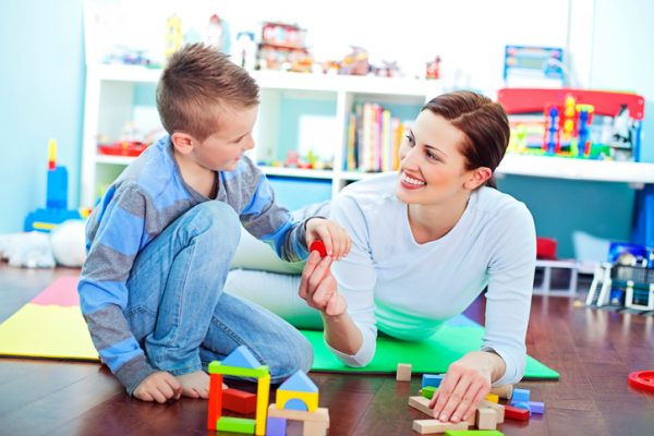 Mom and son playing with building blocks.